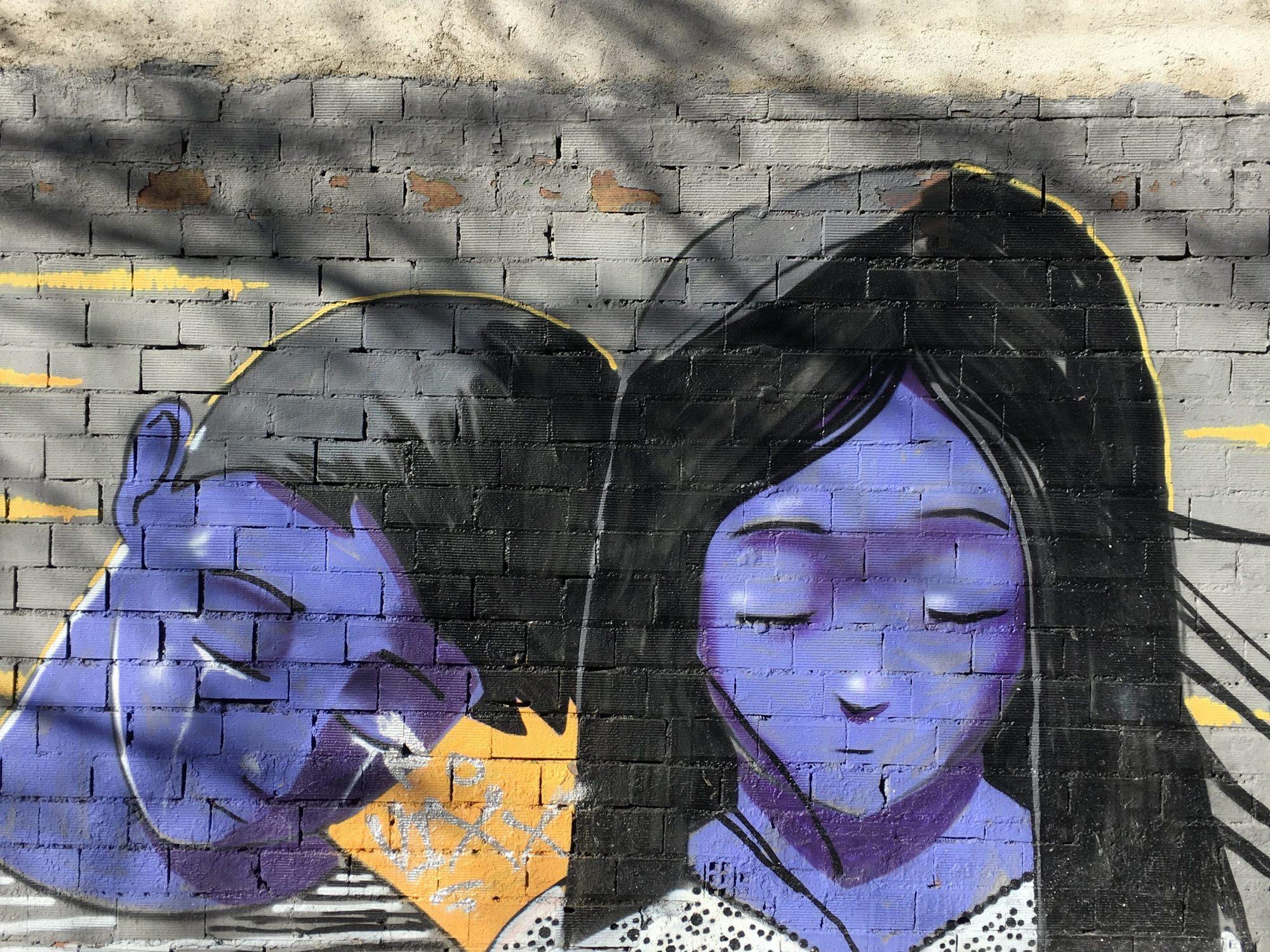 Graffitti of Girl and Boy in Madrid, near Atocha Station